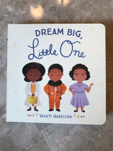 The cover of the board book Dream Big, Little One by Vashti Harrison.