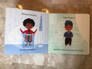 "A page of the board book Dream Big, Little One that reads, ""Shirley Chisholm ran for president. Maya Angelou used her voice every way she could."" The images depict the two women in front of drawn backgrounds."